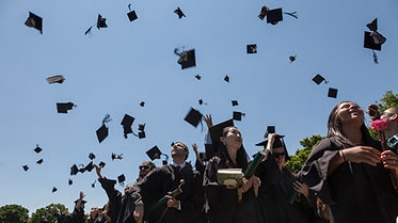 Mortarboards in the air at Commencement.
